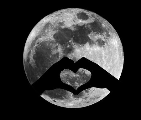 night moon: Silhouette of heart shape under full moon