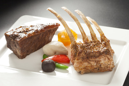 Roasted Rectangle Rack of Lamb Chops on Wooden white dish Stock Photo