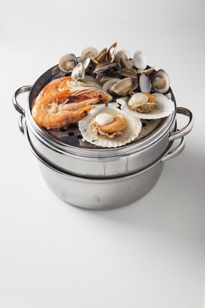 Steam seafood, shrimps, scallops and clams on a steam pot