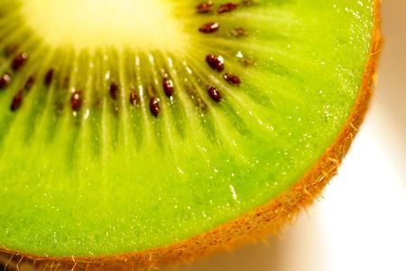 Slices of kiwi fruit on white background Stock Photo