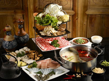 Double favor hot pot soup with wide variety of ingredients Stock Photo