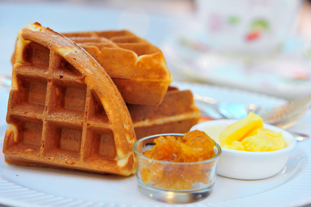 Traditional belgium soft waffles with butter and jam Stock Photo