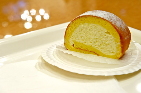 Creamy swiss roll on a white dish
