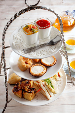 High tea set with dessert. Afternoon tea set Stock Photo