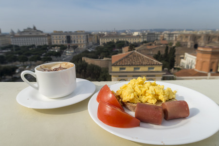 browns: Healthy breakfast with tomato, sausage, scramble eggs and coffee