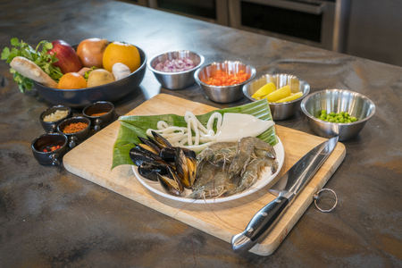 raw: Raw seafood on plate with fruits and vegetables, healthy food, prawn, clam squid.