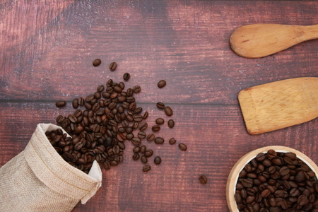 Coffee beans and spoon are placed on the table.