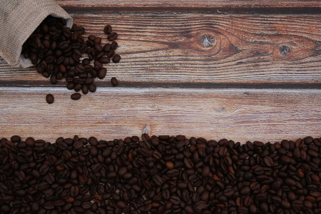 Coffee beans on the table prepared for grinding into coffee powder. Stock Photo