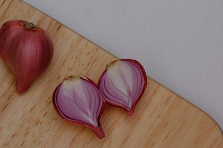 Shallots on the wooden floor in the kitchen