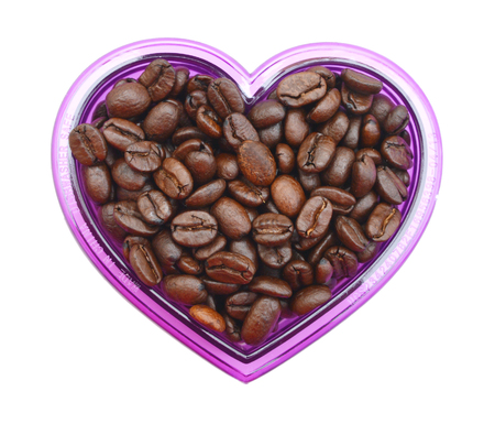 coffee beans in bowl on white background