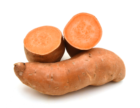 Sweet potatoes in closeup shot isolated on white