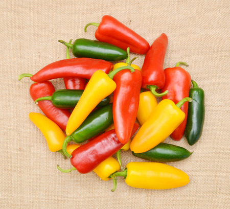Group Sweet Mini Peppers on burlap background