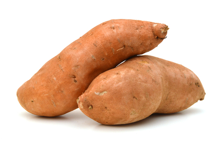 Raw, whole Sweet potatoes isolated on white background