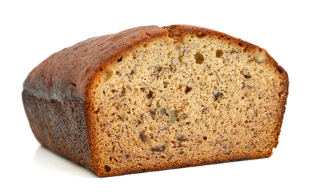 A fresh homemade loaf of banana walnut bread on white background Stock Photo