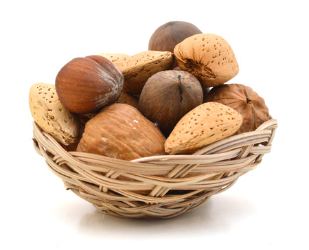 Mixed nuts selection of Brazil,almonds,waln ut and hazelnuts in basket on white
