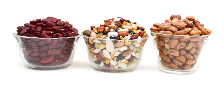 red beans and mixture of legumes in glass bowl on white