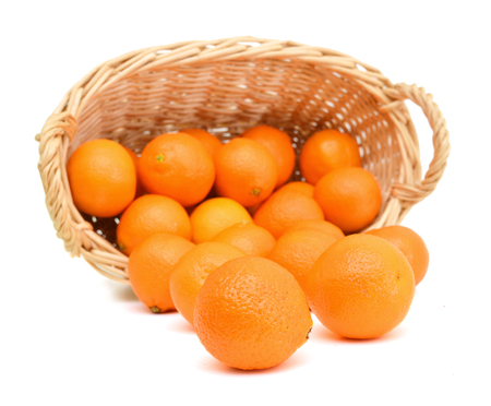 Orange mandarin or tangerine fruit isolated in basket on white background