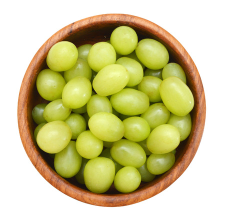 Green  Grapes in a wood bowl isolated on a white background