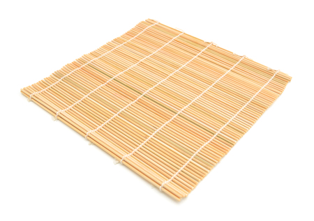 Close up of bamboo mat background isolated on white Фото со стока