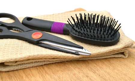 Professional hairdresser tools on color wooden background Фото со стока
