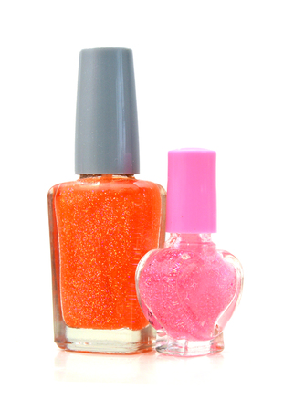 colorful nail polish bottle on white background