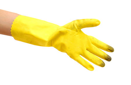 Hand in yellow glove with Stockfoto