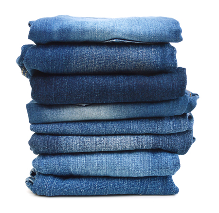Stack of blue jeans a white background Stockfoto