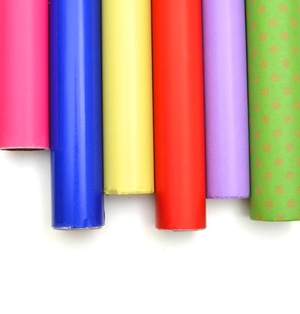 Rolls of colorful wrapping paper on white background Stockfoto