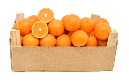 A wood rustic crate full of Clementine Mandarin Oranges.