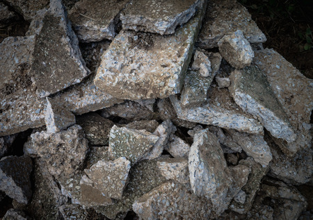 annihilate: Close focus a pile of destroyed concrete in low light effect. Stock Photo