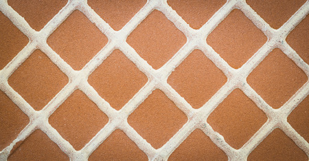 Close up brown square mosaic tile, pattern and background
