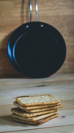Pile of crackers and pan- muted color and split toning effect Stock Photo