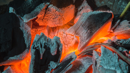 ablaze: Closeup burning charcoals in stove - background and texture