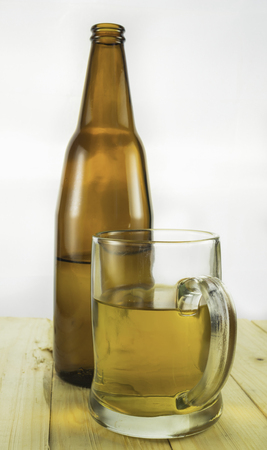 drunkenness: Beer bootle and mug on white background