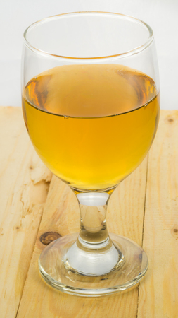 Beer in water goblet on white background