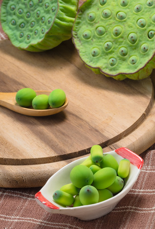 Lotus seeds and lotus pods on wooden block