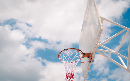 Basketball hoop with blue sky background, outdoor , street sport or recreation Stock Photo