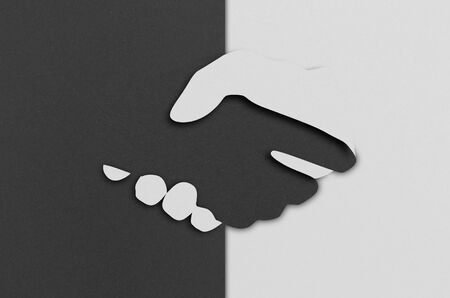 digital papercut style illustration, two hands from different color paper shaking hand, symbol of cooperation or diversity