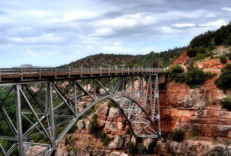 bridge on red rock photo