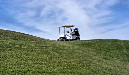 golf cart op de groene Stockfoto