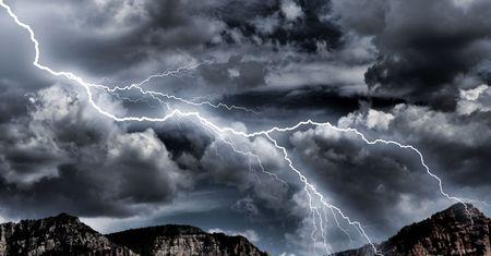 lightning storm over mountains Imagens