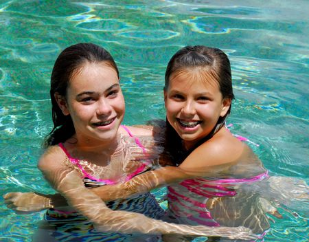 two girls playing in the pool