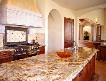 Custom Cabinets: View Of Kitchen With Granite Counters Large Island Stock  Photo