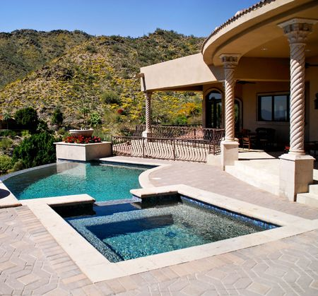 luxuries: backyard patio and view of pool and spa Stock Photo