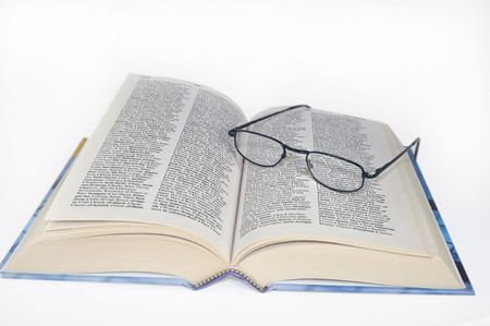 book and eye glasses Imagens