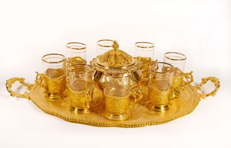 fancy gold tea glasses and tray Imagens