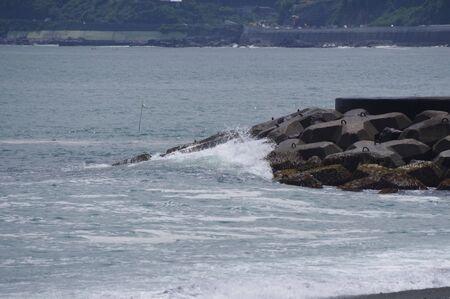 A wave on a breakwater