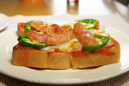 Open sandwich with pizza sauce Stock Photo
