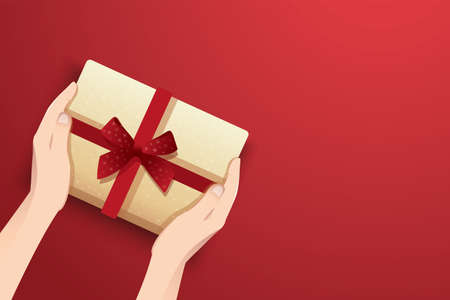 hands holding present box decorated with bow vector illustration