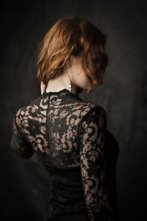 Portrait of young redhead woman in lace dress photo